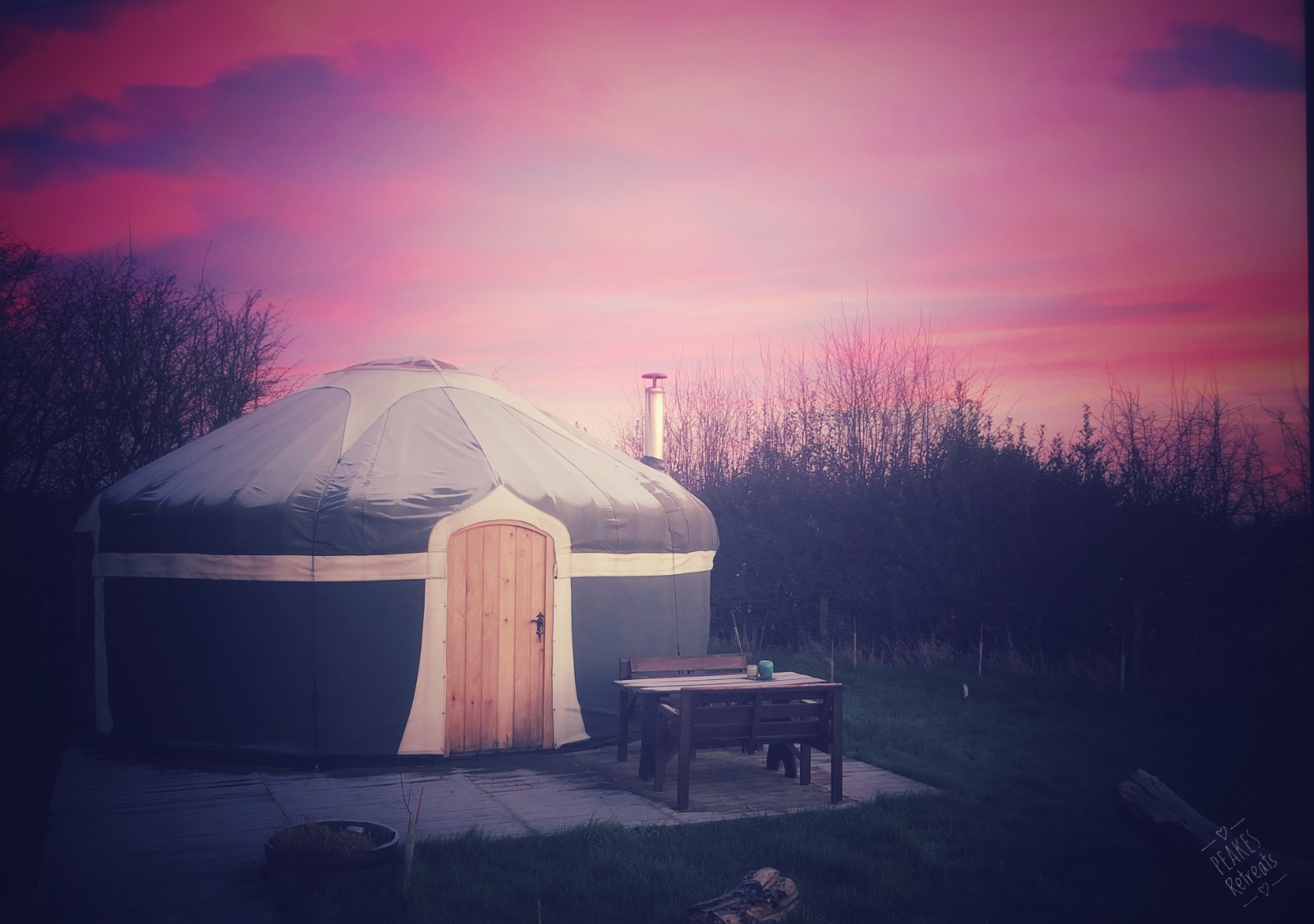 Beautiful pink sunrise behind glamping yurt Staffordshire