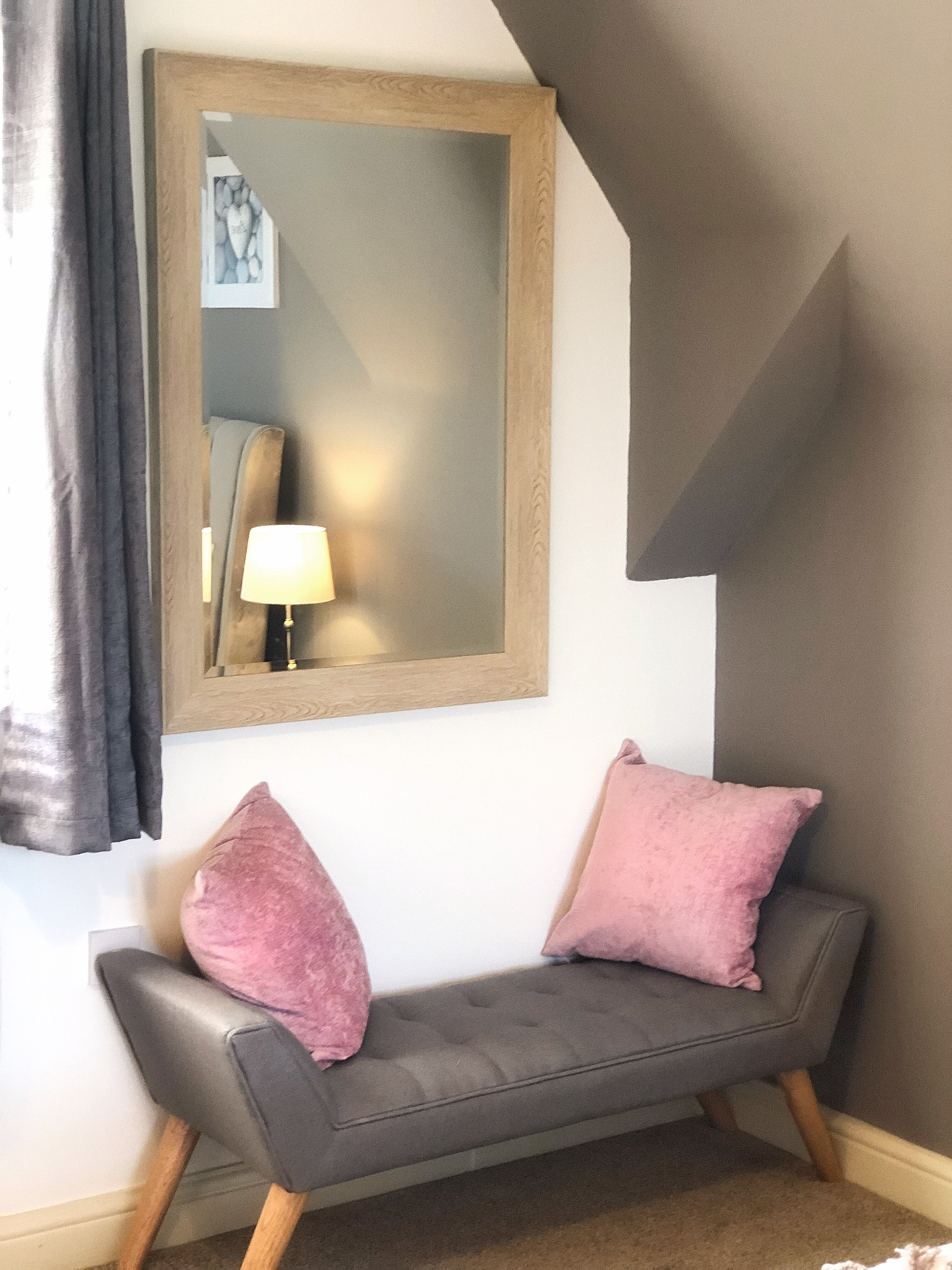 Chaise Longue, pink cushions and a mirror