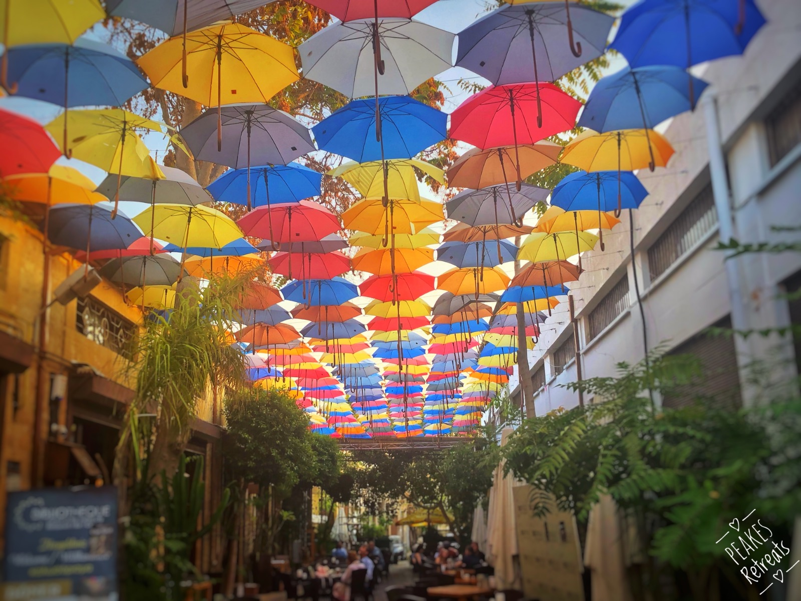 colourful umbrellas shade Cyprus street cafe