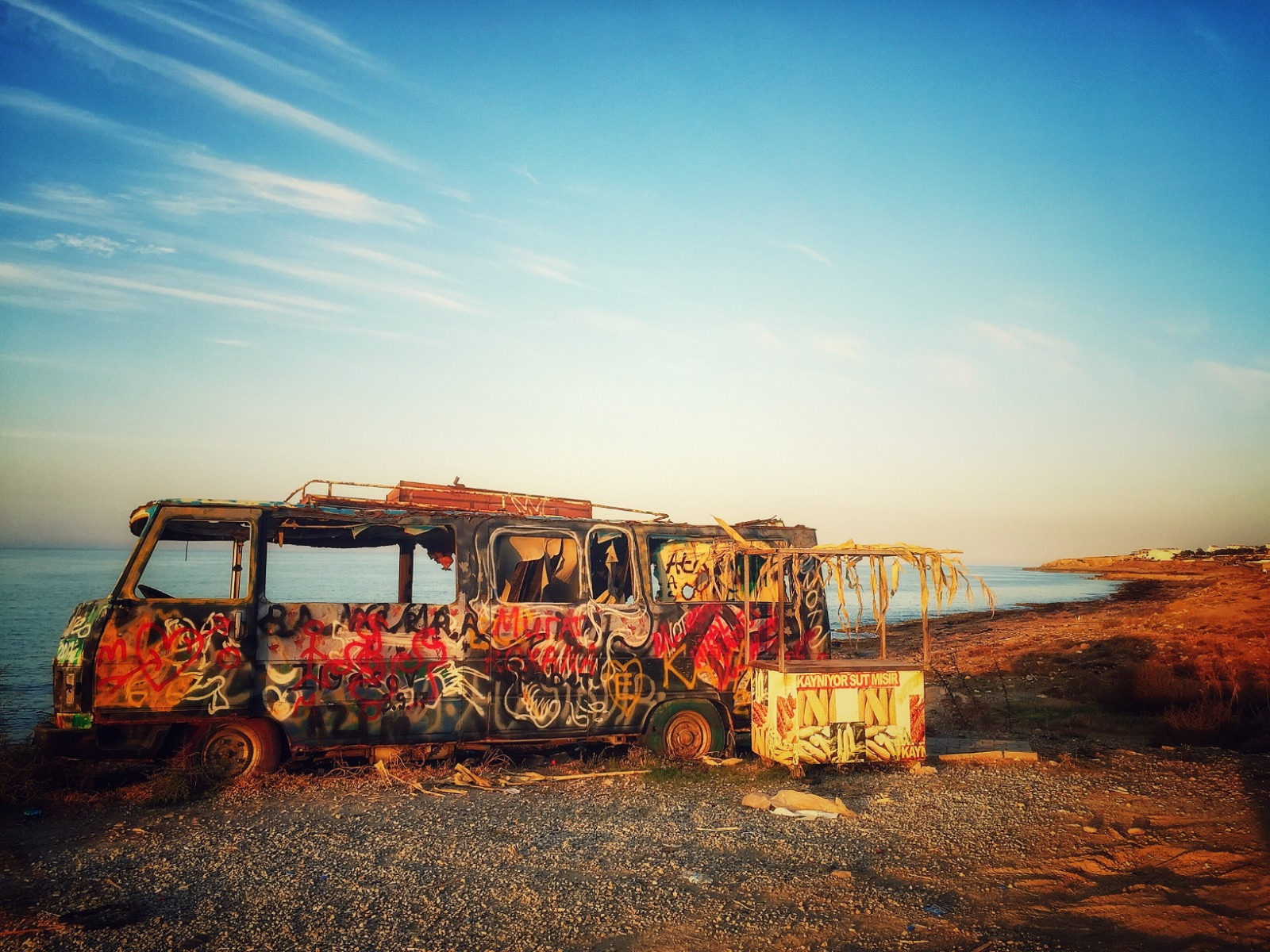 Graffiti bus next to the beautiful Mediterranean Sea in North Cyprus