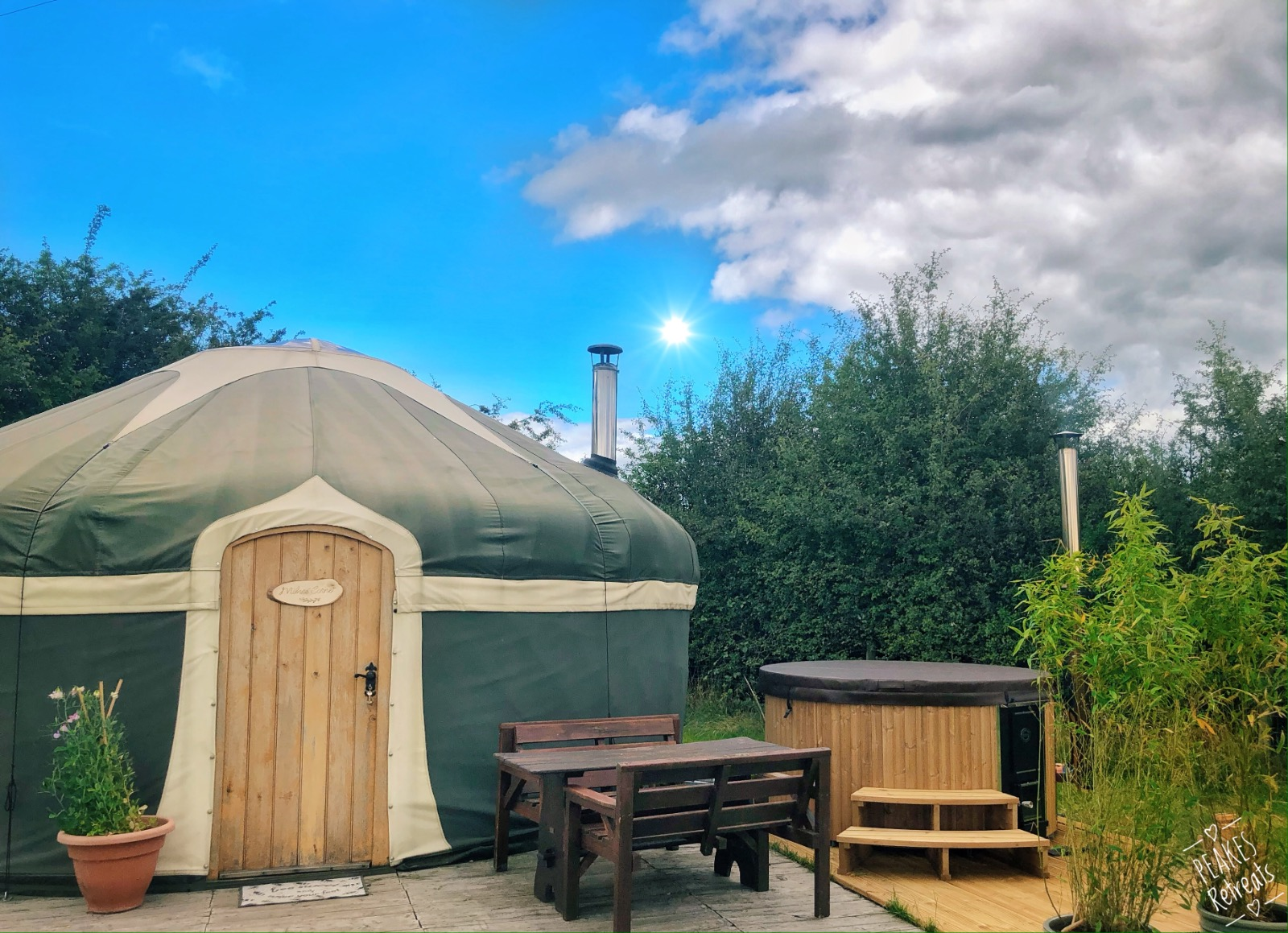 G;amping yurt with private hot tub on sunny day