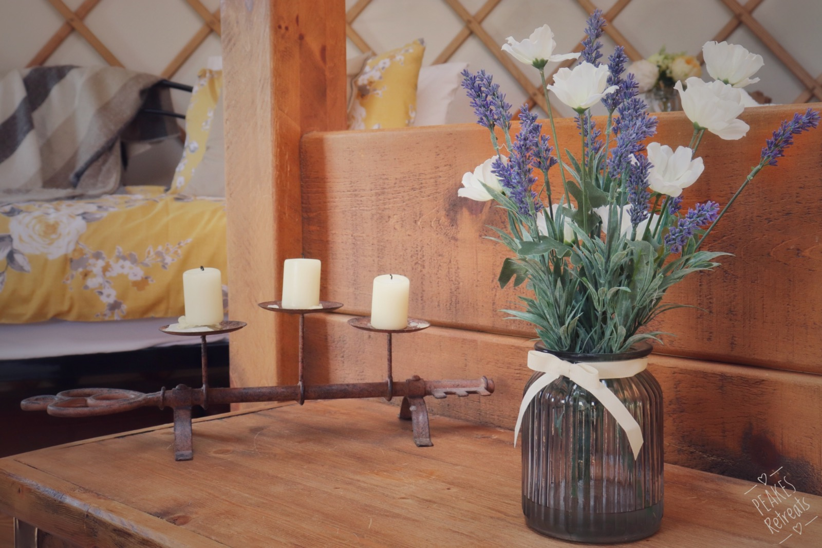 Candle holder and artificial flowers in beautiful yurt