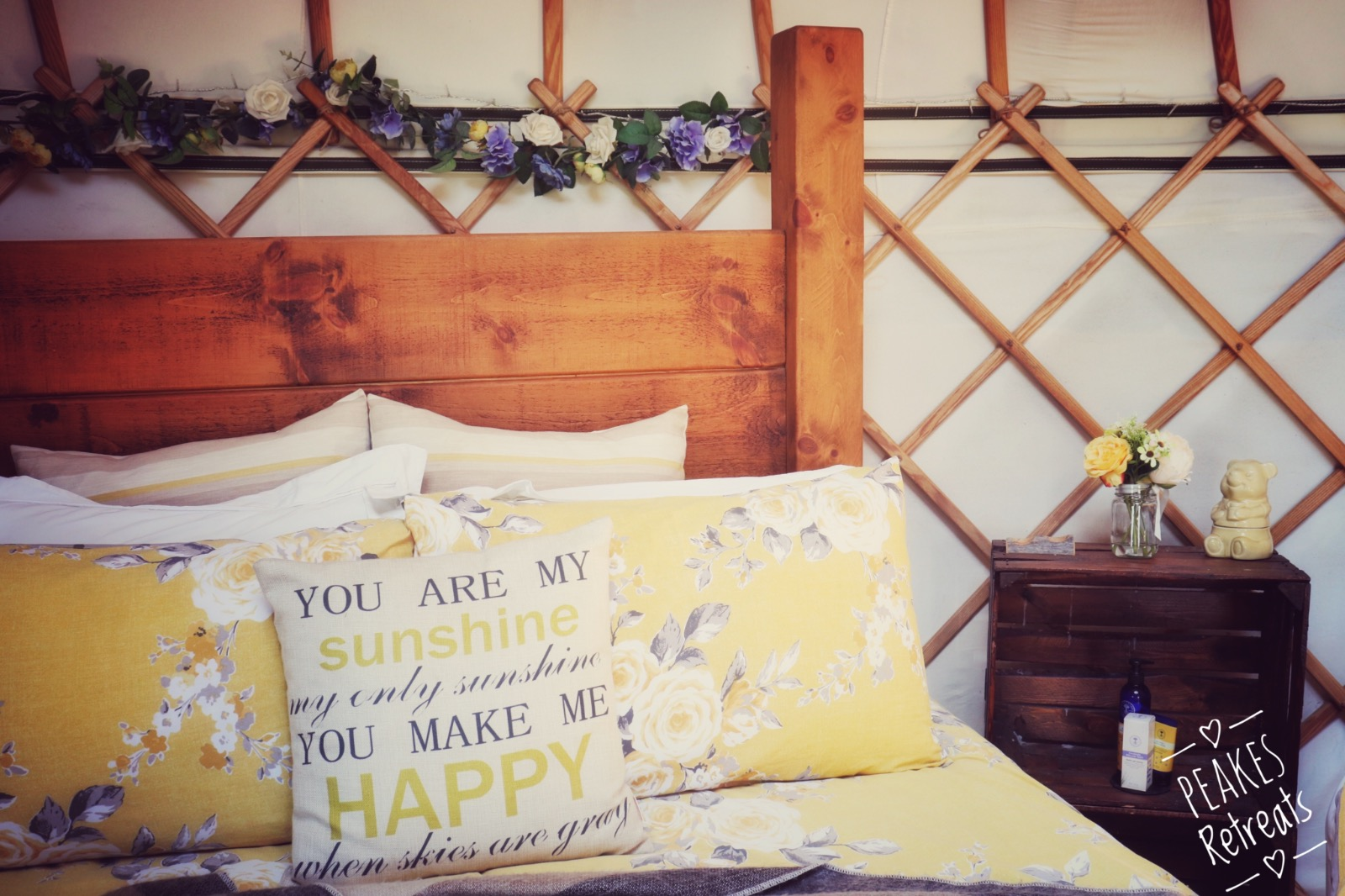 Yellow bedding in wooden four poster bed