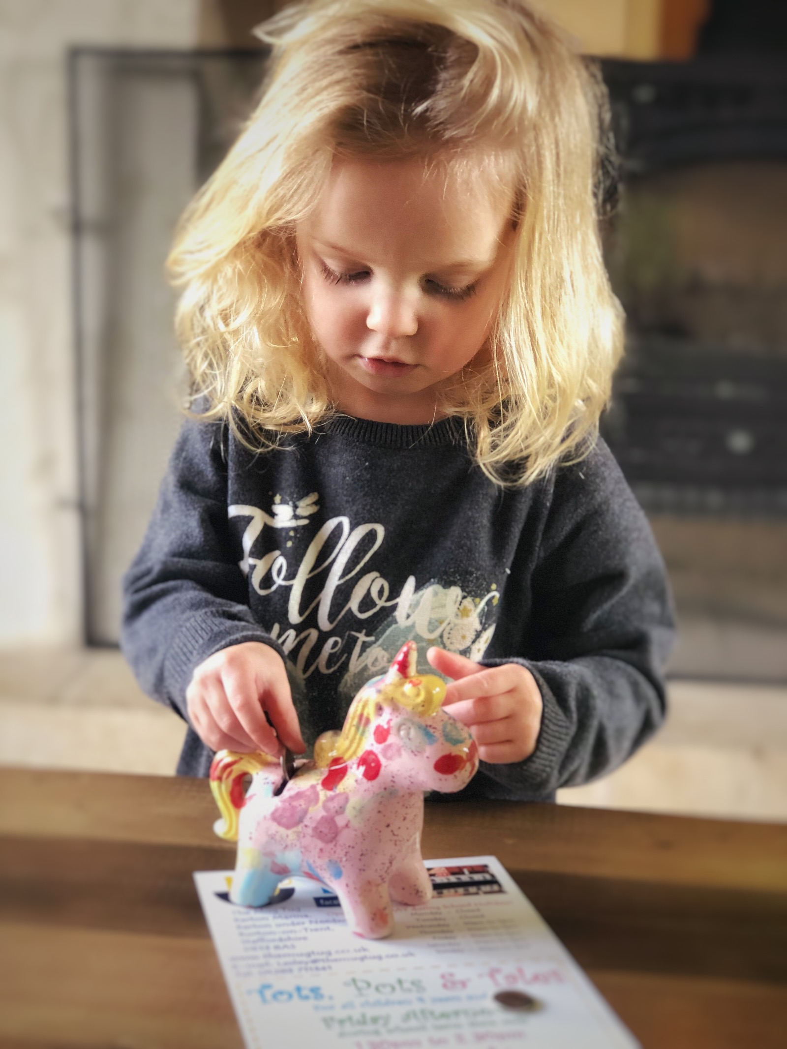 Blonde haired Little girl with painted unicorn