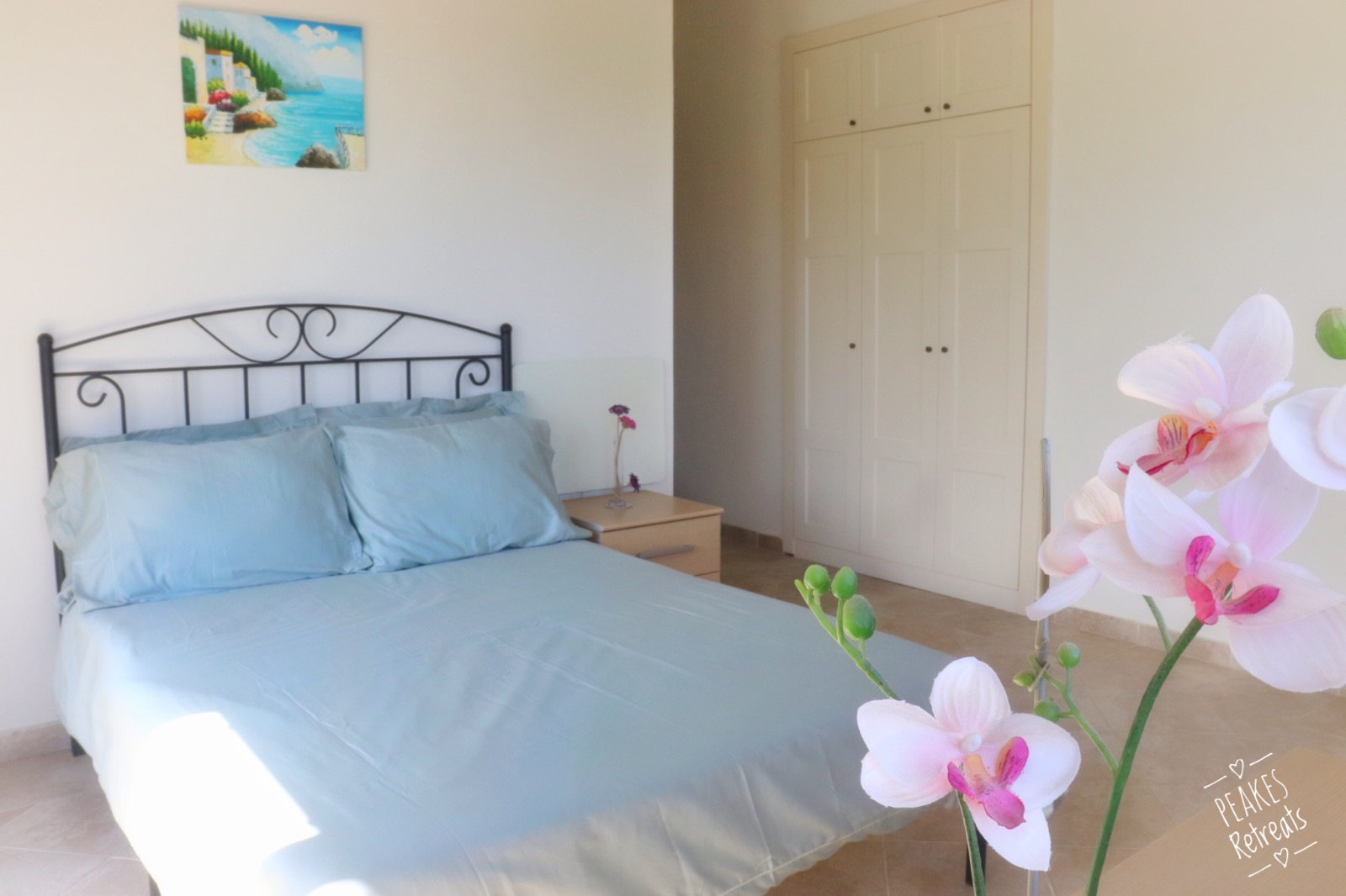 Double bed, sage green bedding, large bedroom, fitted wardrobes, orchid