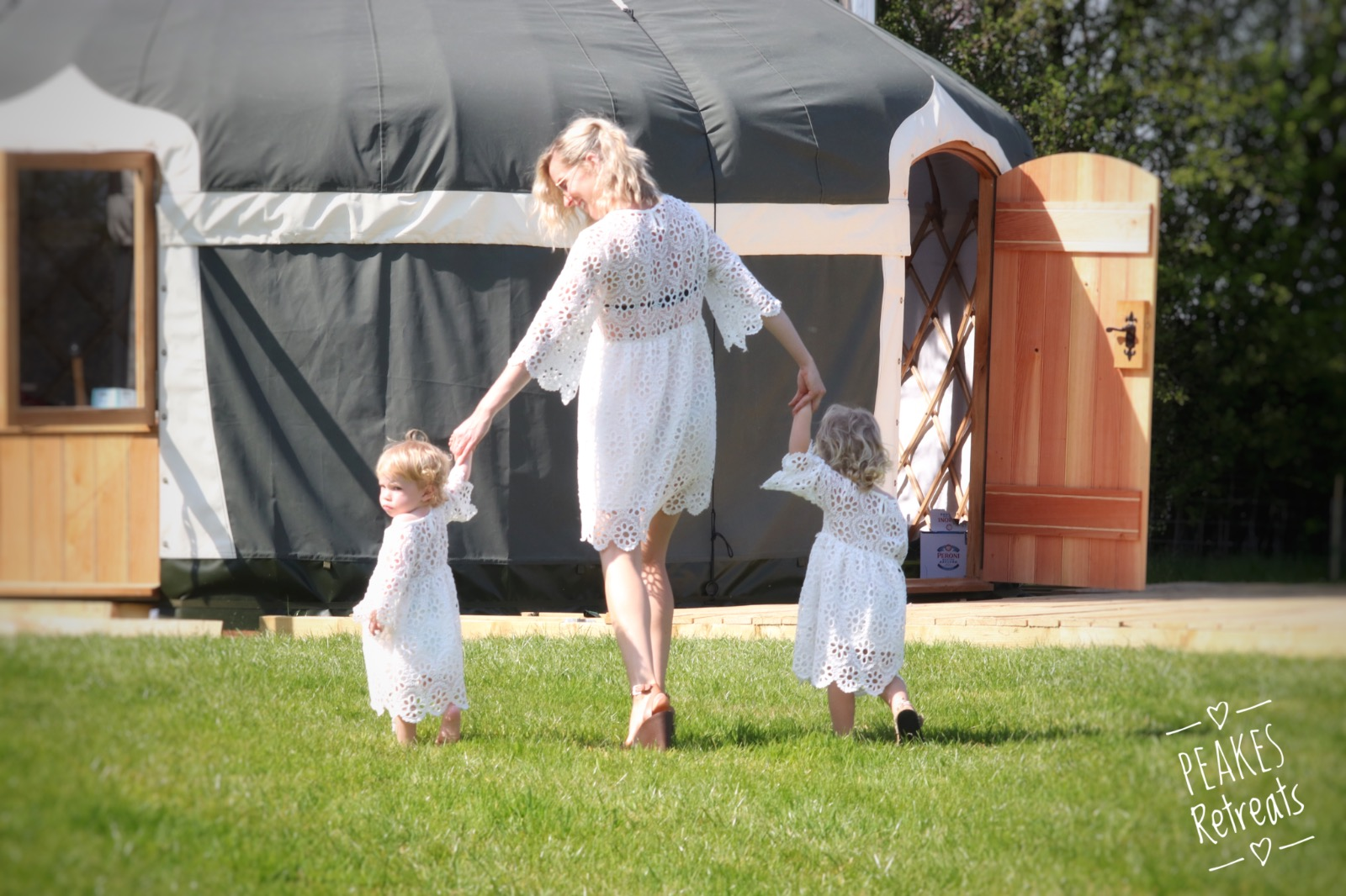 Mum and two children, matching outfits glamping in yurt