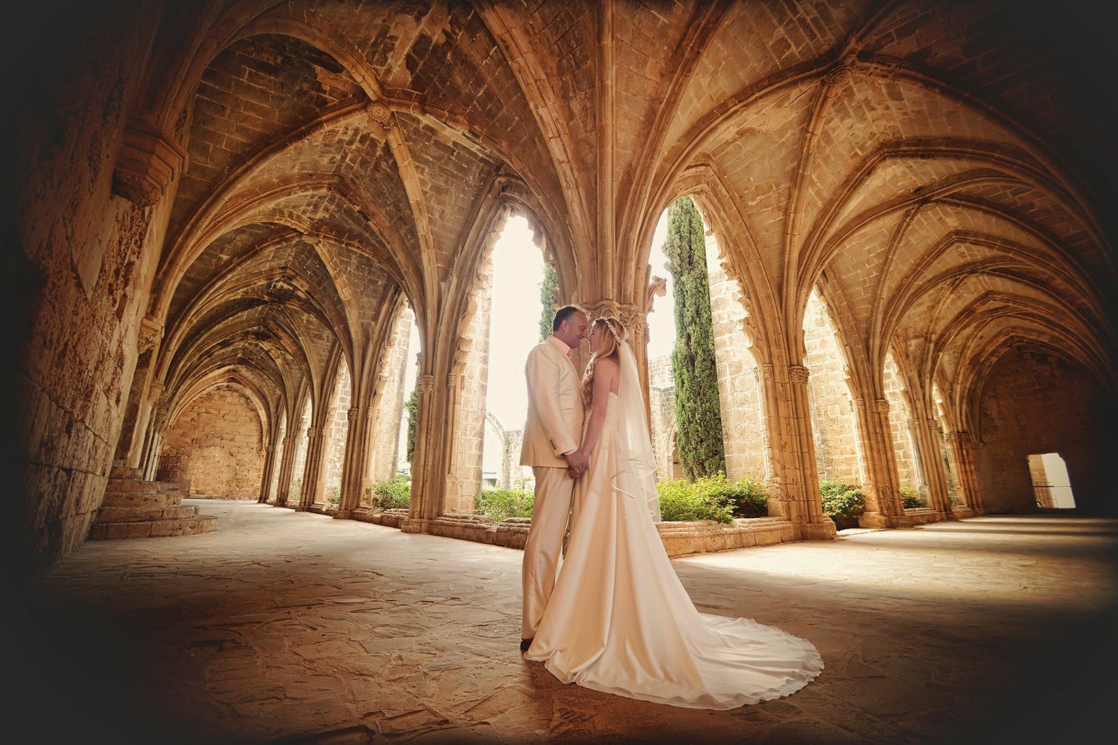 Bride and groom get married on holiday in Beautiful bellapais monastery ruins north cyprus