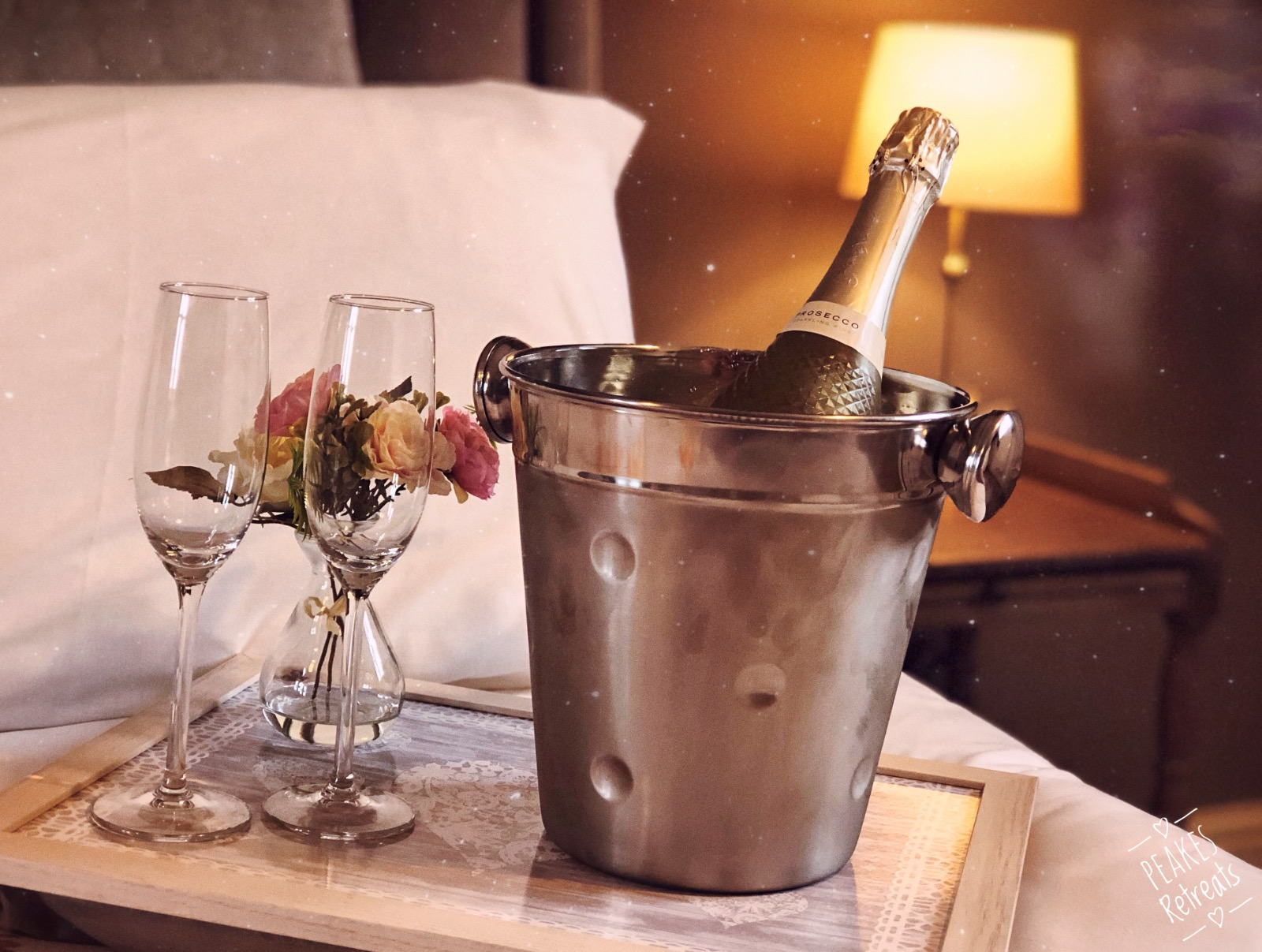 chilled champagne on a superkingsixe bed, romantic getaway