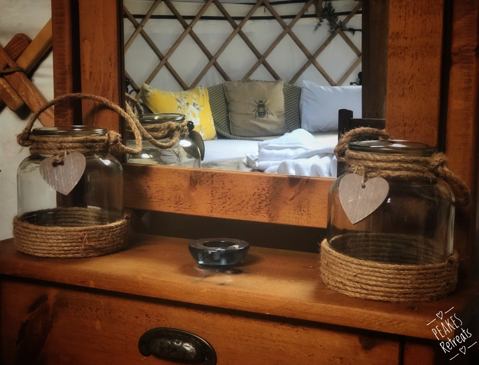 Glamping yurt interior, candles and dressing table