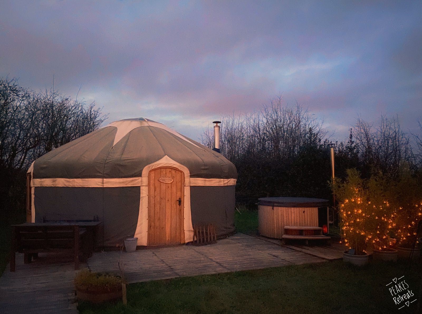 yurt with wood fired hot tub and solar powered fairy lights