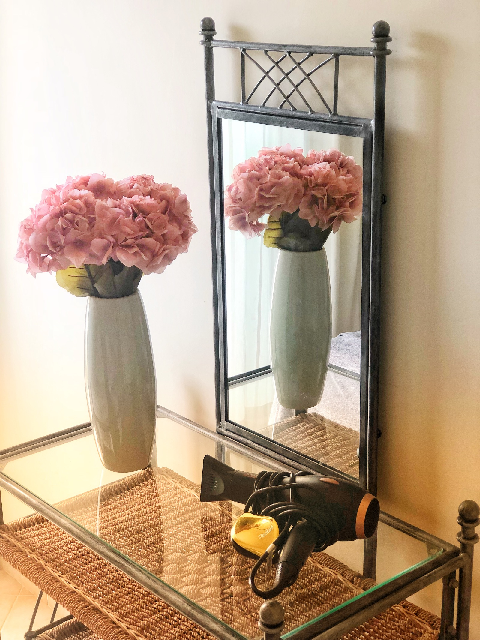 Dressing table with hairdryer and beautiful hydrangeas