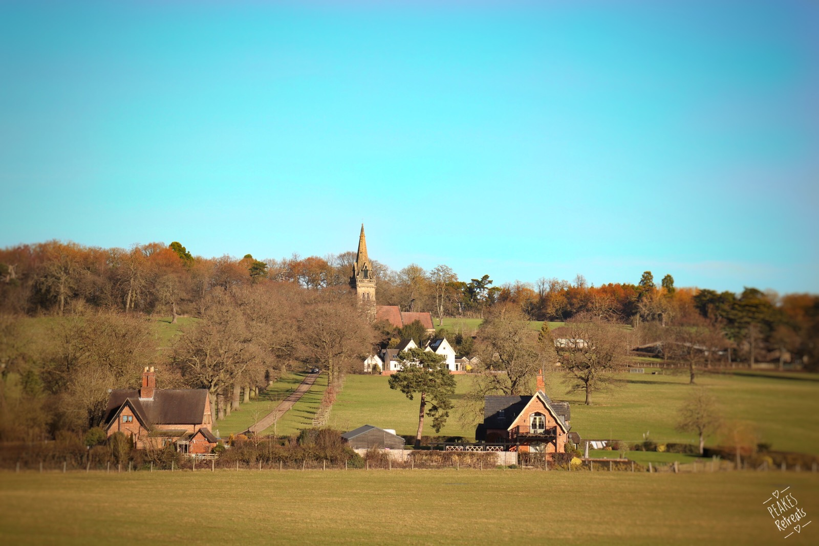 Small countryside village church on a sunny day surrounded by field
