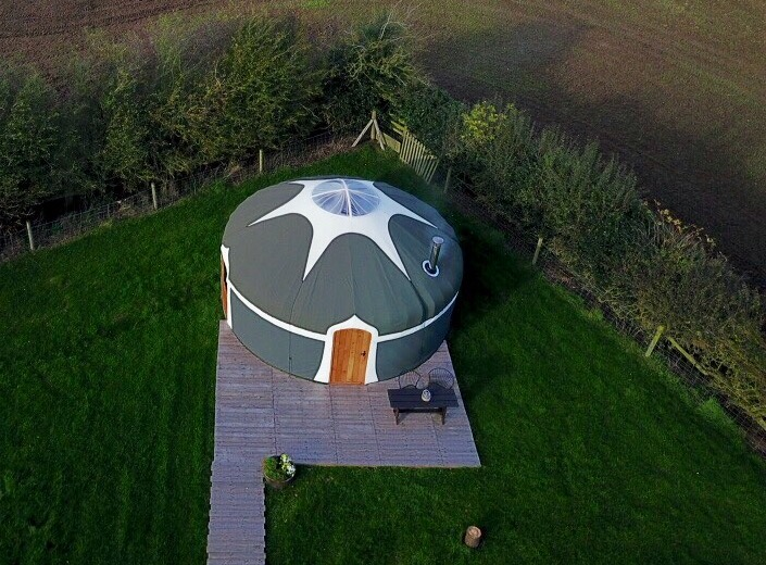Our lovely Milne's Corner yurt from above, drone photo capturing the setting around our glamping yurts