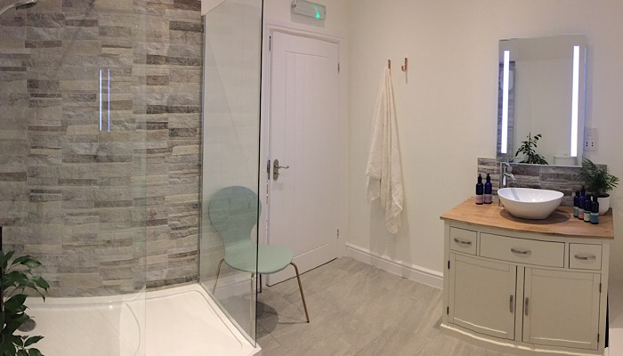 Shower and get ready in style in our luxurious shower rooms, complete with vanity basin and Neals Yard Remedies Organic beauty products. This is glamping, luxury camping