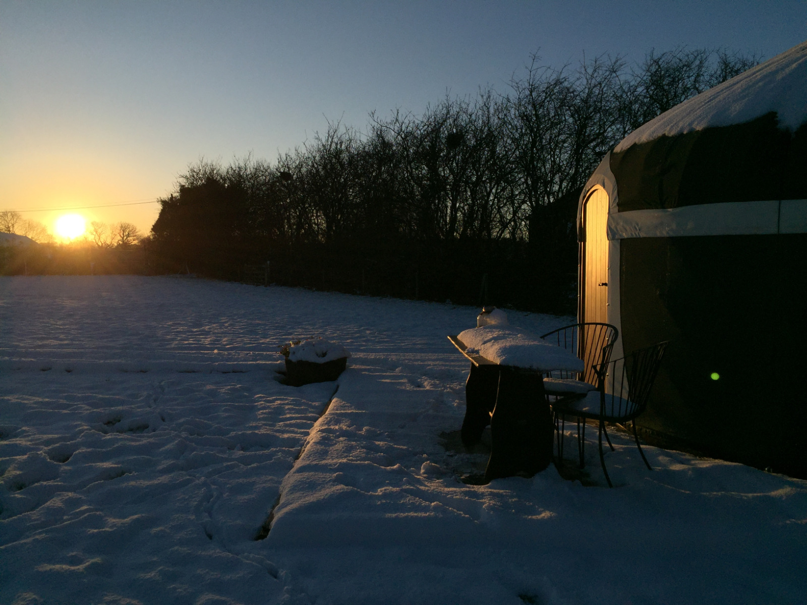 Enjoy a romantic winter sunset from our Milne's Corner yurt, luxury glamping at it's best.