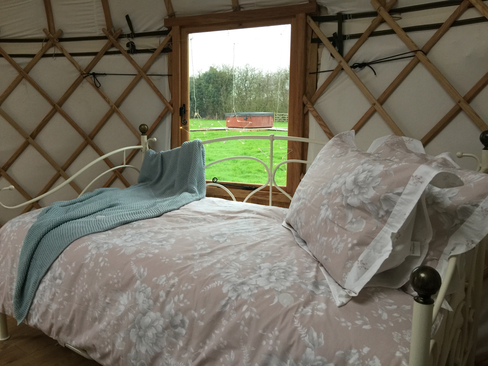 Close to the hot tub you can enjoy a relaxing glamping trip in Potter's Lodge yurt. Pretty romantic bed linen and a cosy warm yurt