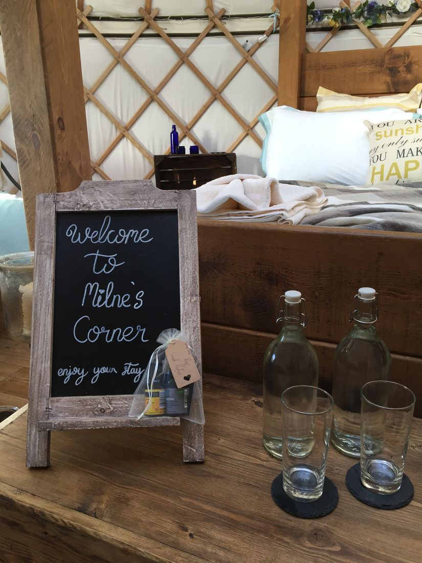 Chalkboard welcoming guests to our Milne's Corner yurt for a glamping weekend.