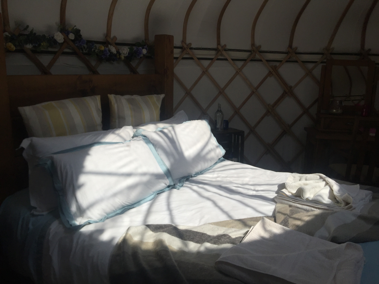 King size wooden rustic bed in luxury yurt milnes corner, in the sunshine