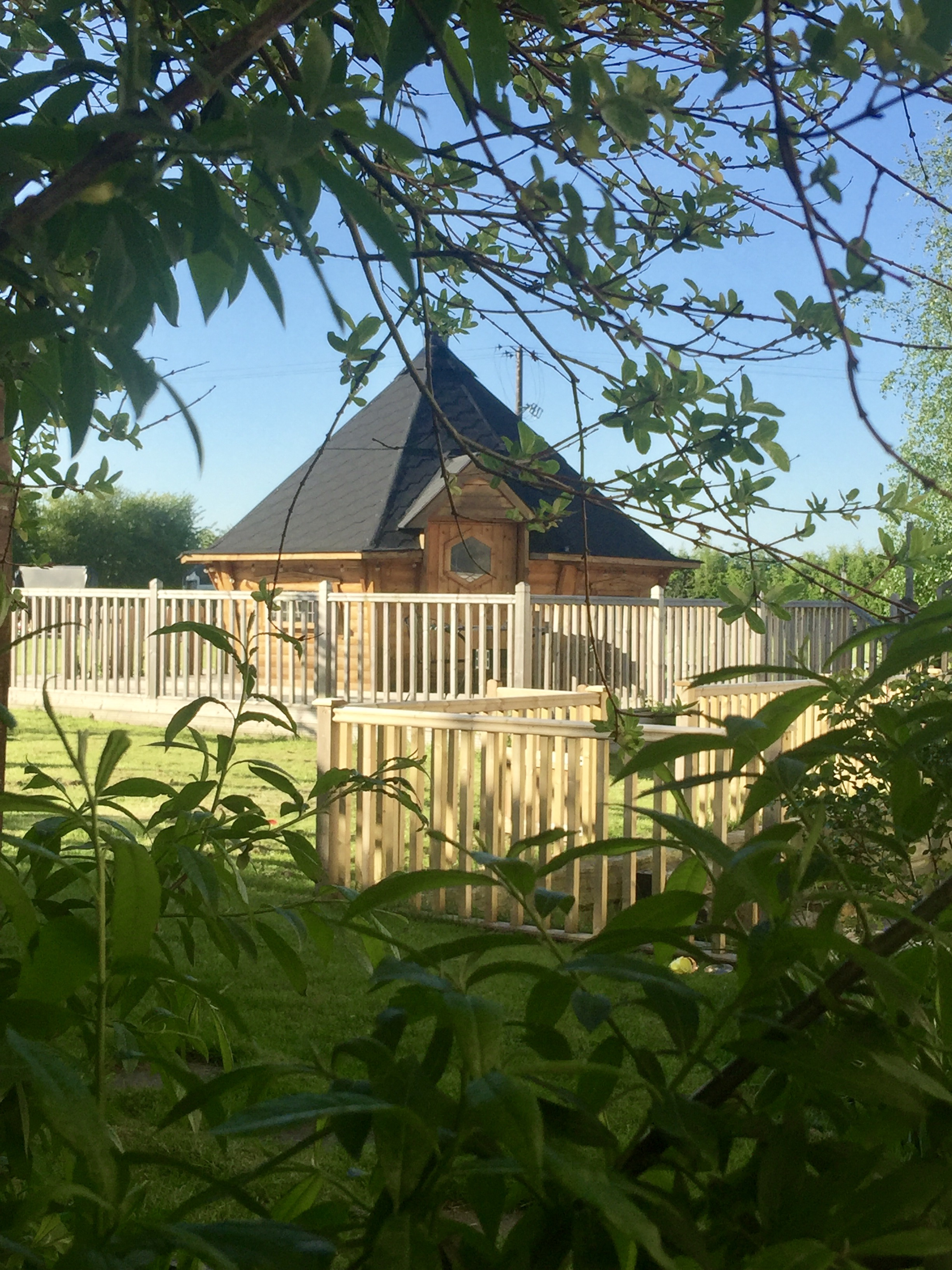 Finnish BBQ hut in the sunshine, glamping, luxury camping